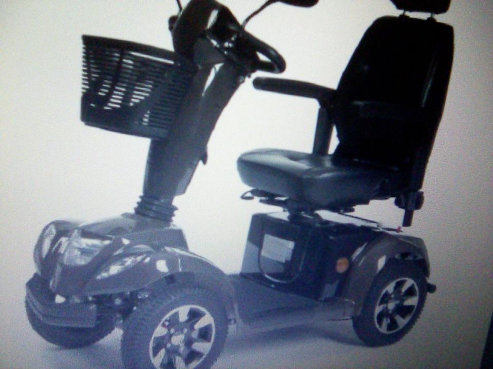 Scuter electric pentru persoane cu deficienta de mers
