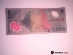 Vand bancnota de 2000 lei cu eclipsa de soare